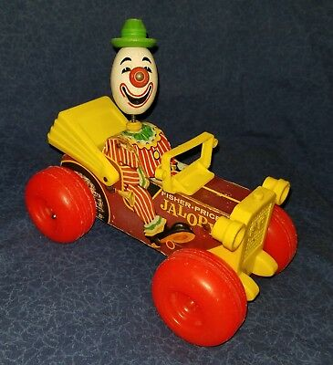 Vintage 1965 FISHER PRICE Clown Driving JALOPY #724 Pull Toy, good condition.