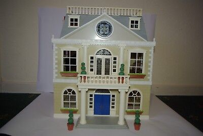 Sylvanian Families Grand Hotel with accessories.
