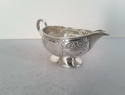 Pretty, Embossed Antique Solid Silver Oval Cream- Jug.         London. 1887.