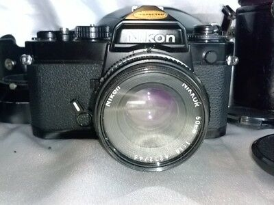 VINTAGE NIKON 35 MM CAMERA BODY along with 3 lenses and case AS IS CONDITION