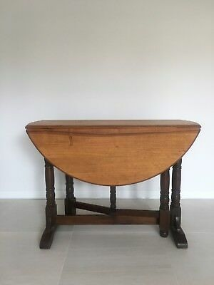 Round drop leaf timber table