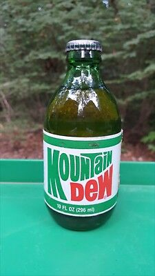 1986 Nos 10 Oz. Full Styrofoam Label Throw Away Mountain Dew Bottle