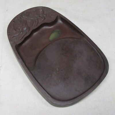 B842: Japanese calligraphy tools. An ink stone with monkey relief work