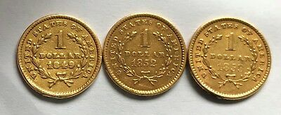 Five different US $1.00 Gold Dollar Coins with loops removed from rim