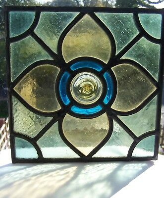 Victorian stained glass panel with flower design