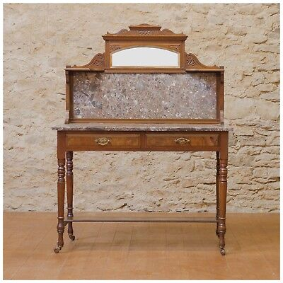 An Antique wash stand with marble top and back