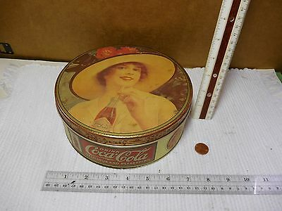 """1984 COCA-COLA COKE GIRL WEARING HAT METAL COLLECTOR TIN 7.5"""" x 3"""" ROUND CAN"""