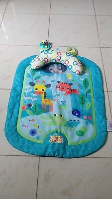 tummy time play mat, pillow and toys