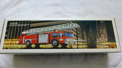 1986 HESS RED FIRE TRUCK BANK,  MINT in its Original Box