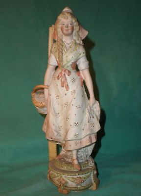 antique figurine of a fisherwoman fishnet, paddles and basket antique/ bisque