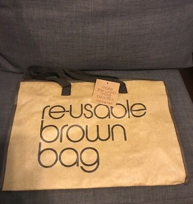 New with tag Bloomingdales Brown Reusable Bag-Zipper closing.