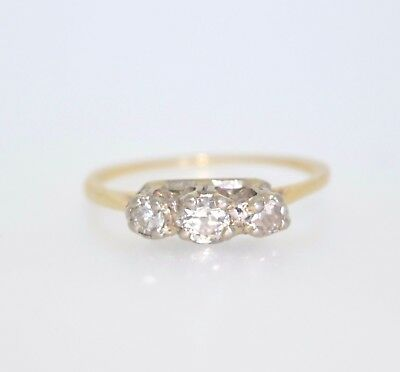 A mid 20th century platinum and 18ct gold diamond ring. RECEIVE BEFORE CHRISTMAS