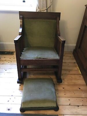 Old wooden rocker chair and foot stool