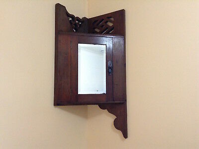 Antique solid wood corner cabinet with bevelled mirror