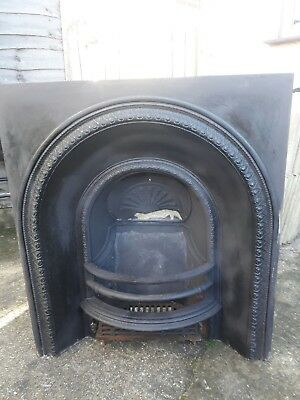 Cast iron fireplace with grate