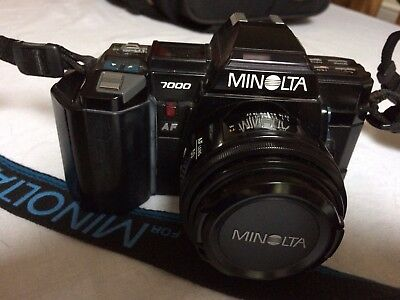 MINOLTA 7000 Camera complete with 3 Minolta lenses,flash and owners manual.