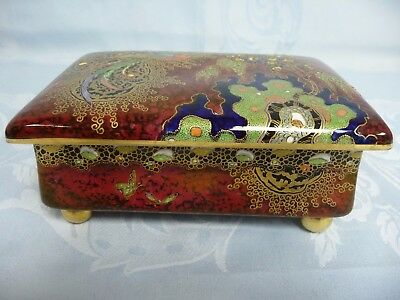 ANTIQUE CARLTON WARE COVERED BOX, RED w/BIRD OF PARADISE & GOLD BALL FEET