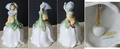 Avon 1983 Porcelain Flower Shaped Bell with Pixie Elf and Four Leaf Clovers