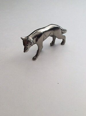 The Great American Prowling Wolf Polished Pewter. Canada