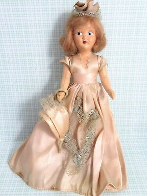 Vintage 1950s Hard Plastic Doll Wearing Beige-Pink Dress & Hat 7.5 Inches Tall