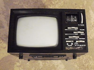"Vintage Lenoxx sound deluxe 5"" black and white tv/am fm radio"