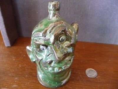 Super Marvin Bailey, Lancaster, SC MINI GREEN Color Face Jug with crooked smile
