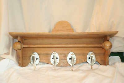 Antique small pine shelf with spoon hooks and a rail