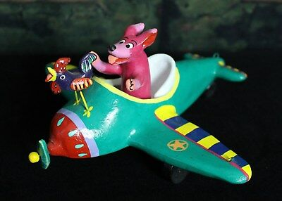Dog & Rooster go flying in a plane! Playful Mexican folk art by Ortega Family