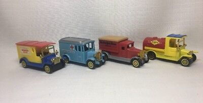 (Bb) 4 Diecast Plastic Reader's Digest Trucks Made In China
