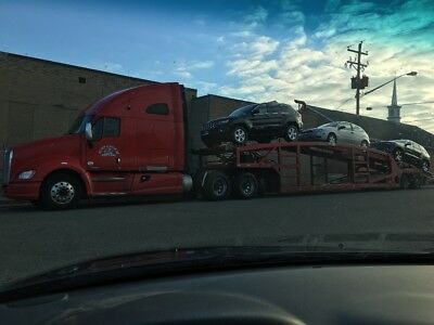2011 kenworth T700 with 2001 Cottrell 6-7 car hauler