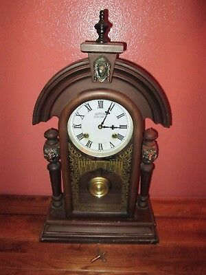 Antique Vintage Non-Working Southern Clock Company with Lion & Face Decoration
