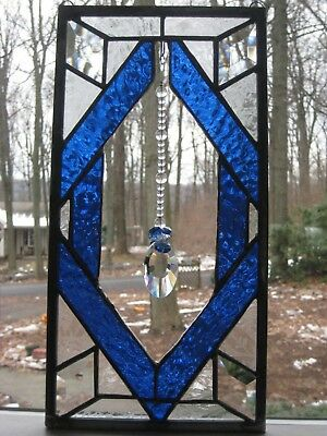 Stained glass panel with hanging  large crystal pendant