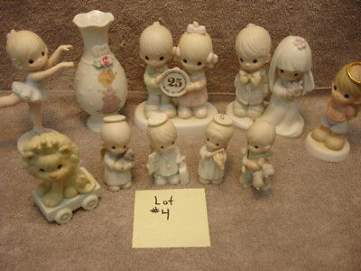 Lot # 4 Precious Moments collection.