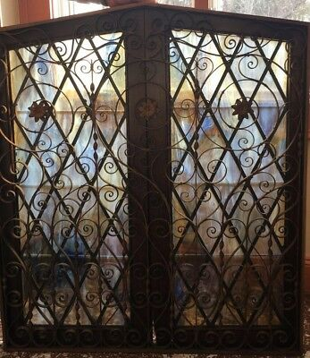 Beautiful 1927-1930 leaded stained glass and wrought iron set.