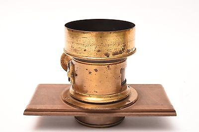 Vintage brass lens with lensboard. Good condition