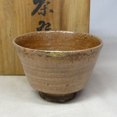 C129: Japanese old HAGI pottery tea bowl of good atmosphere w/golden repair