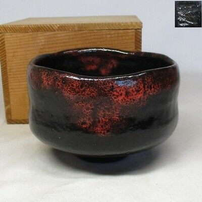 C131: Japanese KURO-RAKU pottery tea bowl with good glaze and work