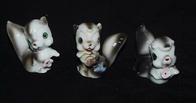 3 Vintage Bone China Mini Skunks With A Flower