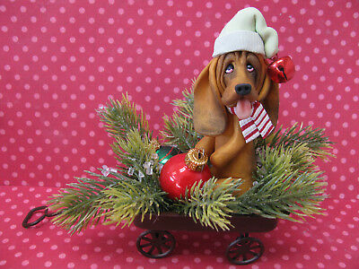 Handsculpted Bloodhound in Christmas Wagon Figurine