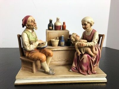 Vintage Apothecary Figurine Man Woman With Sick Child Exc Condition