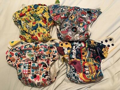 Lot of 4 cloth diapers with sewn in inserts and pockets-one size