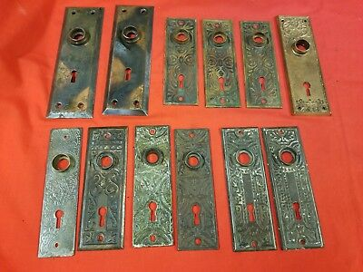 Group of 12 Antique Door Knob Backplates