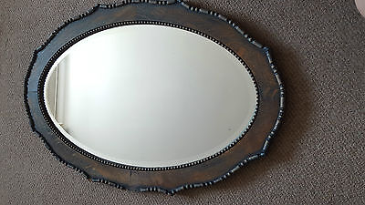 A magnificent Art Deco fluted oval bevel edged mirror. captivating and unique