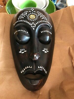 Indonesian wooden mask with inserts