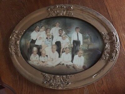 Antique Early 1900s Family Portrait in Large Oval Wood Frame with Convex Glass