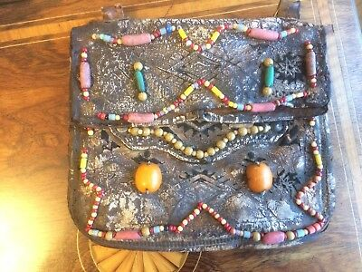 Antique tribal art bag decorated with amber beads possibly native American.