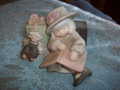 Kim Anderson Figurine    Girl Sleeping w/Packages   3 1/2 by  3 Inches