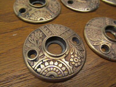 8 Old Door Knob Rosettes Brass ? Bronze ?...nice Ornate