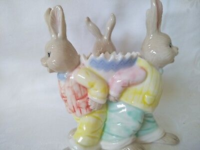 Three Bunnies supporting Egg cup Made in China