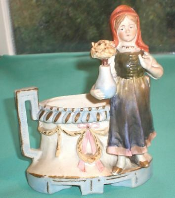 figurine of a girl with flower pot in front a bowl, antique/ bisque/Germany